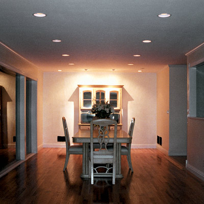 dining area with retrofit light fixtures that look like can lights