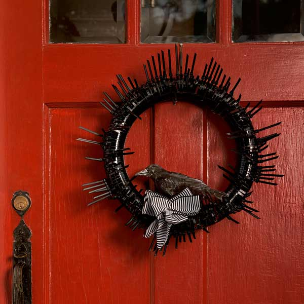 black gothic halloween wreath on front door, easy upgrades around the house throughout the year