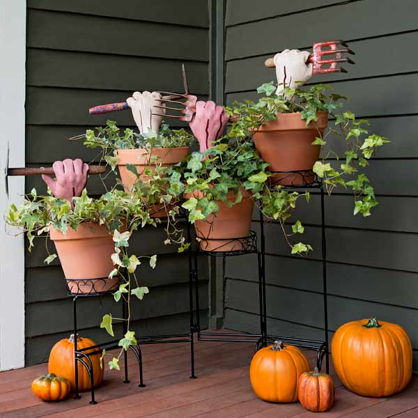 halloween container plants with fake zombie hands holding antique gardening tools, easy upgrades for whole house throughout year