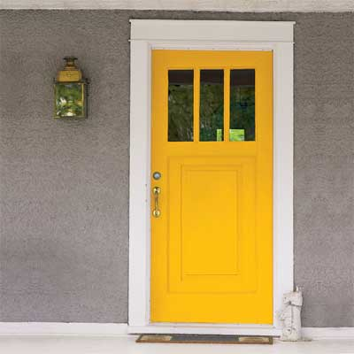 yellow front door personalized with paint