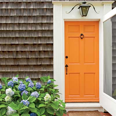 bright orange front door personalized with paint