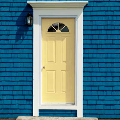 Pale Yellow front door personalized with paint