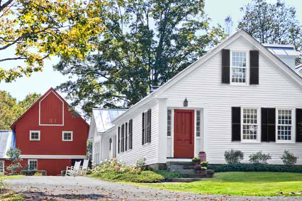 exterior of farmhouse and barn remodel after
