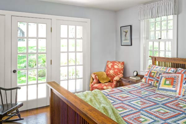 whole-house farmhouse remodel after master bedroom with French doors
