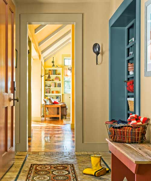 whole-house farmhouse remodel after main entry with built-in storage
