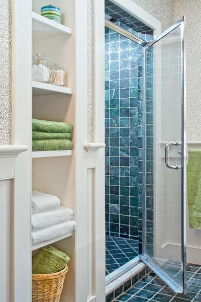 whole-house farmhouse remodel after shower with open shelving for towels in bathroom
