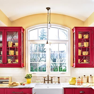 family in red and white kitchen with Shaker-style flat-panel cabinets