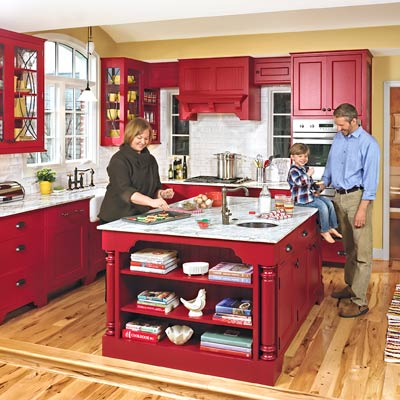 red Shaker-style flat-panel cabinets, vaulted ceiling that echoes window and retro pulley light pendant