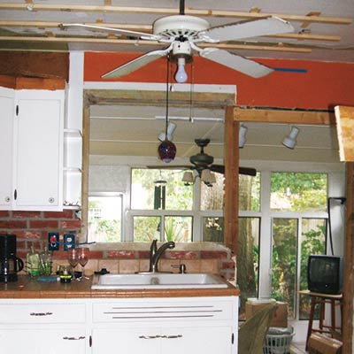 Kitchen with Marble Tile, Concrete Counters, Wood Cabinets and Butcher-Block Island
