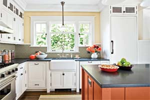 open craftsman kitchen design with island and schoolhouse lights