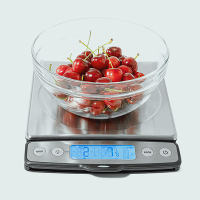 OXO food scale with glass bowl of cherries 