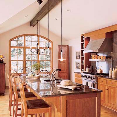 wood kitchen with wood cabinets and open plan