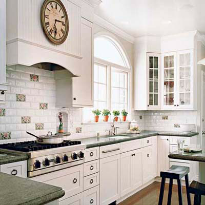 white kitchen with subway tiles and glass-fronted cabinets