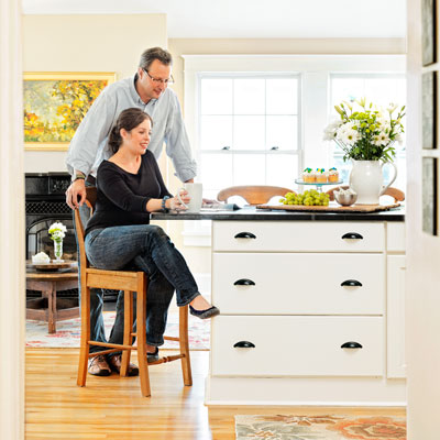 kitchen remodel after couple sitting at breakfast bar