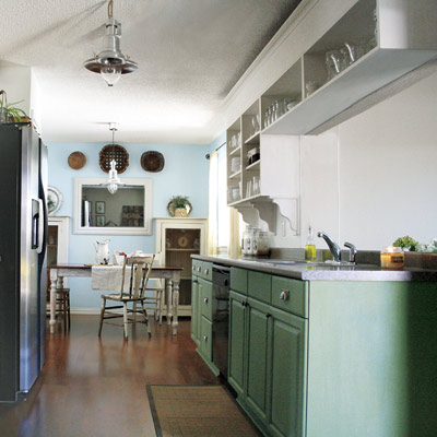 farmhouse-style kitchen with green cabinets