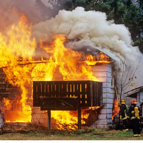 fire fighters fighting a house fire