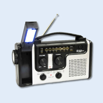 radio and phone charger with a hand crank