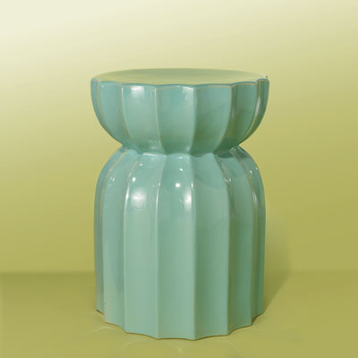 an aqua-blue, fluted ceramic garden stool