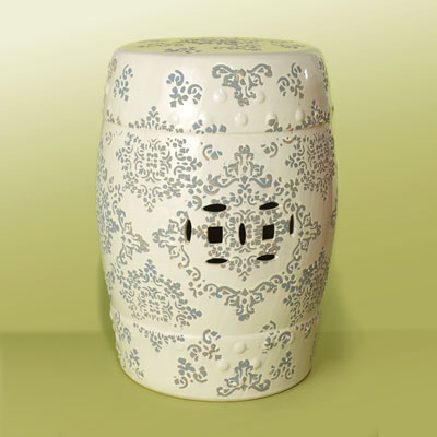 a white ceramic garden stool with grey, Indian-style pattern