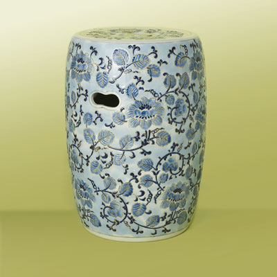 a blue and white ceramic garden stool with Asian design