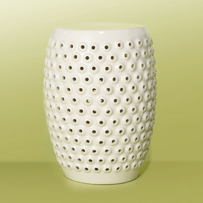 a white ceramic garden stool with pierced bubble designs
