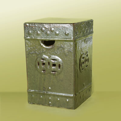 a box-shaped, metallic green ceramic garden stool with rustic design
