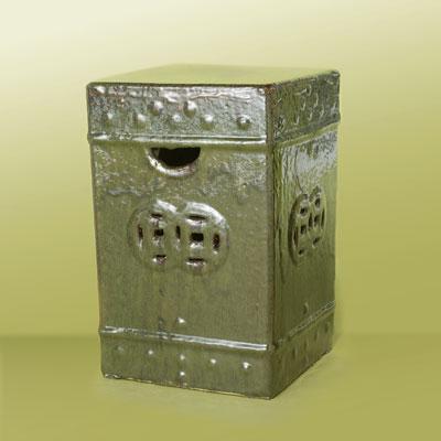 a box-shaped, metallic green ceramic garden stool with rustic design