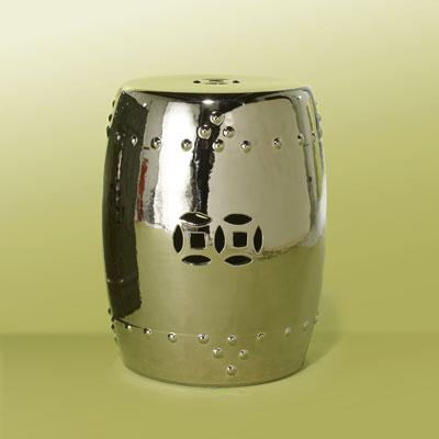 a shiny chrome-glazed ceramic garden stool