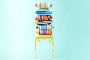 outdoor throw pillows stacked on a chair
