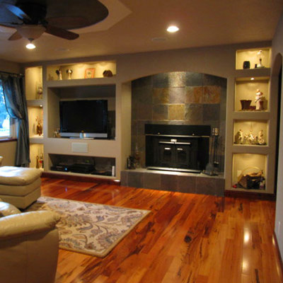 built-in shelves around fireplace in living room