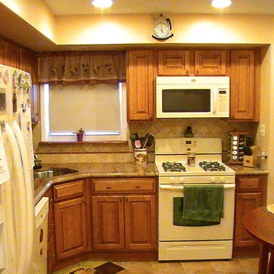 kitchen with wood cabinets, marble countertop, white appliances