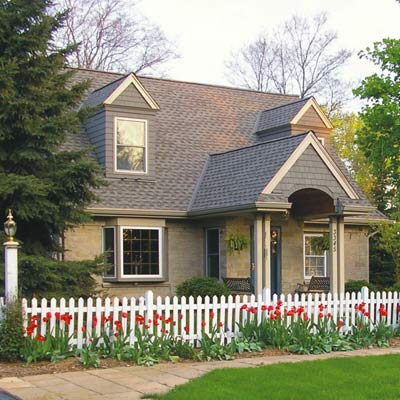 New England style house with white picket fence
