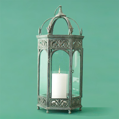 Powder-coated brass with a green-patina finish metal candle lantern