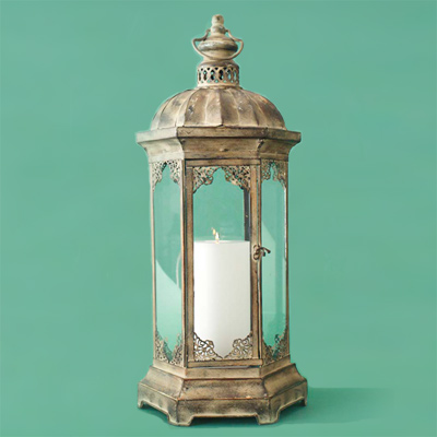 Painted iron with a patina finish metal candle lantern