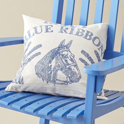 grain-sack pillow on blue painted rocking chair