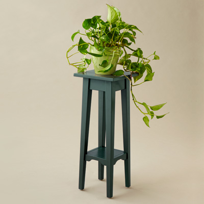 green painted plant stand 