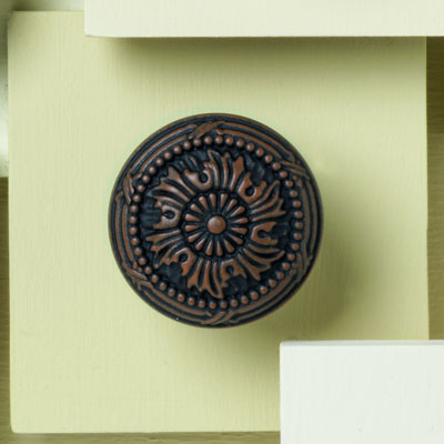 zinc cabinet knob with a ribbon design