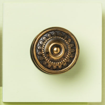 zinc cabinet knob with a bronze beaded design