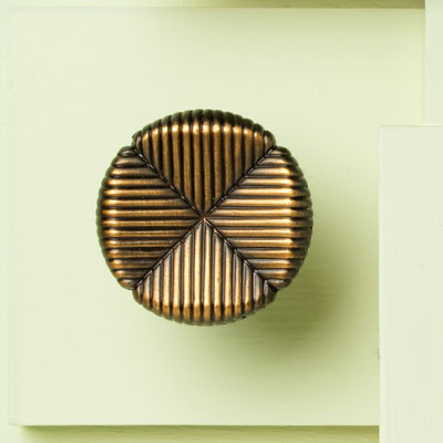 zinc cabinet knob with textured clover design