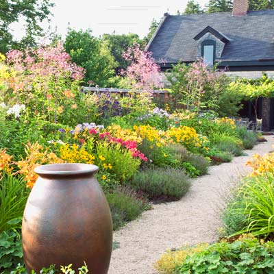 a colorful garden path forming a strong diagonal with a house in the background