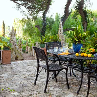 black oval aluminum dining set in garden