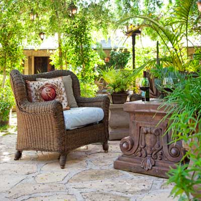 rust-finished iron dining sets in casual lounge in garden with lion stone fountain