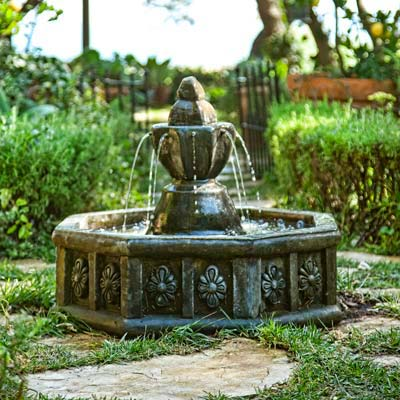 fountain with ocotgonal basin in herb garden