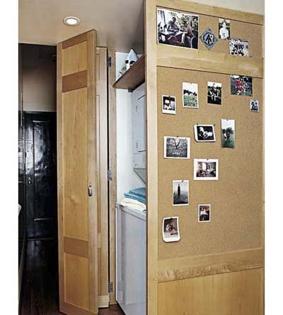 laundry closet with cork bulletin board
