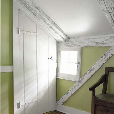 closet under the stairs and chimney