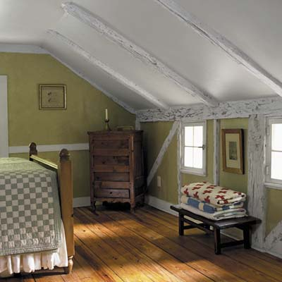 master-bedroom has pine floors and painted and glazed beams