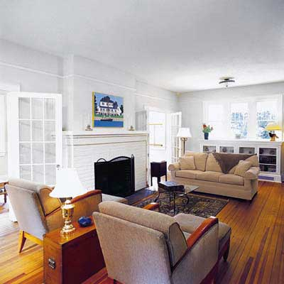 a Craftsman living room with built-ins and French doors