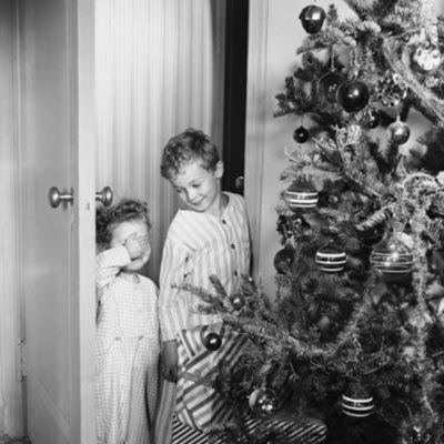 vintage christmas photograph with children in front of christmas tree