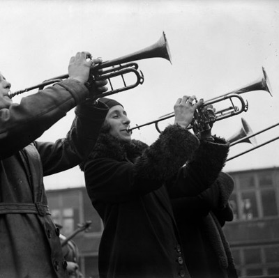 vintage christmas photograph of women playing trumpets