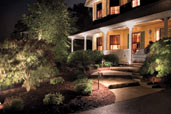 house front yard at night with path lighting